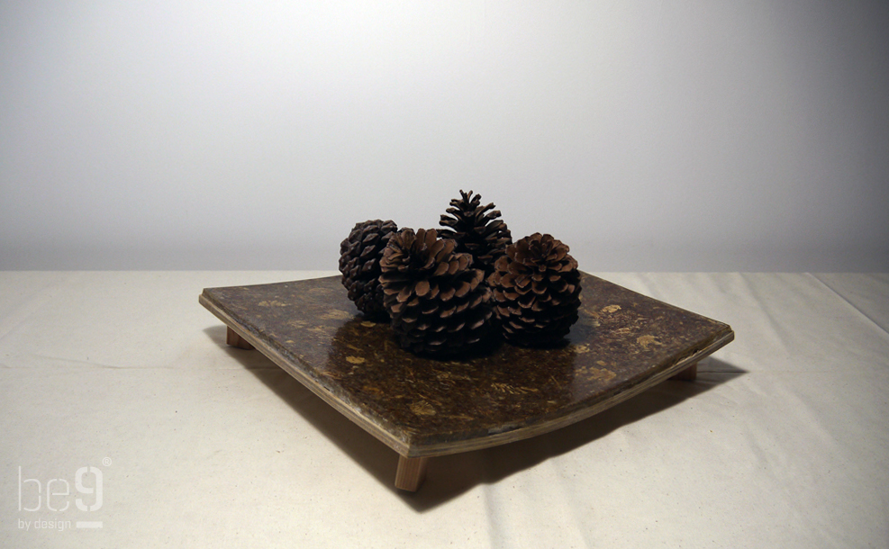 Square plateau with pinecones